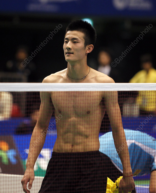 Naked female badminton player think, that