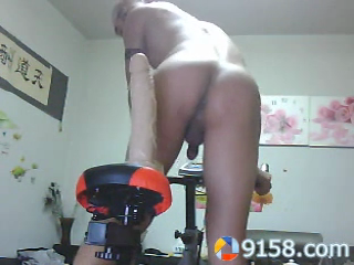 chinese-tattoo-hunk-riding-dildo-bike-at-home-03.png