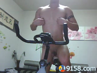 chinese-tattoo-hunk-riding-dildo-bike-at-home-10.png