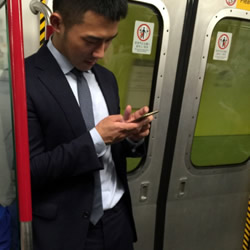 Fit Asian Dude on Metro